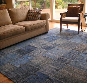 Blue overdyed patchwork rug in livingroom