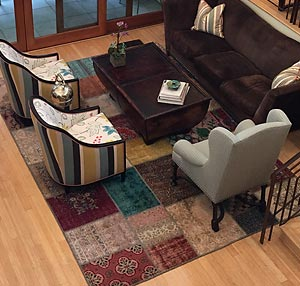 Colorful patchwork rug in sitting room