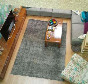 Gray overdyed rug in living room