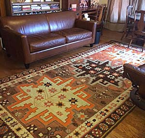 Kilim rug on wooden floor