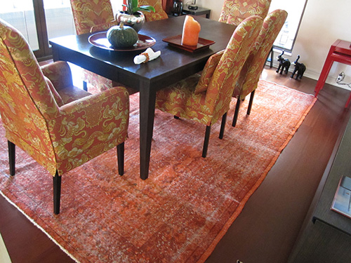 Orange overdyed rug in living room