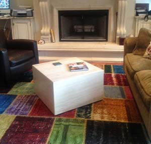 Overdyed patchwork rug infront of fireplace