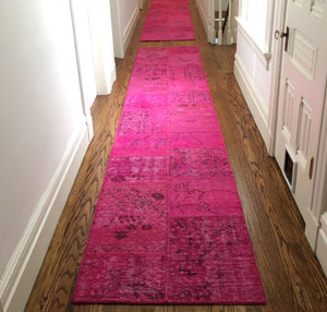 Pink overdyed patchwork rug in the hallway