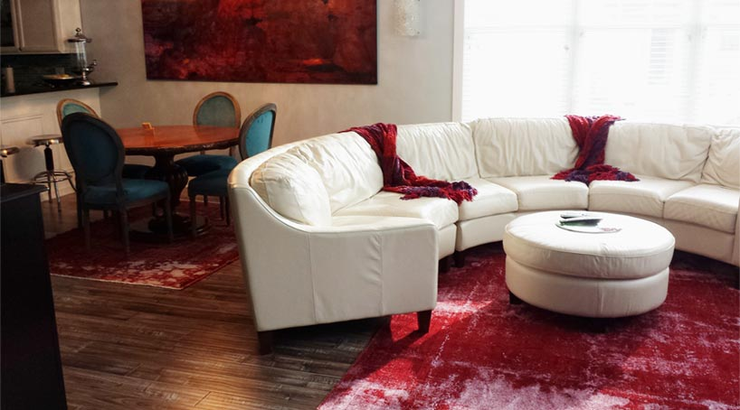 Red overdyed rug in living room