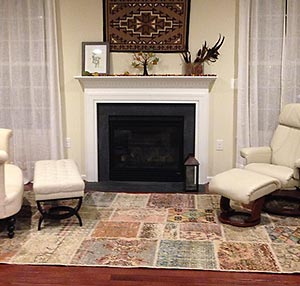 Vintage patchwork rug in front of fireplace