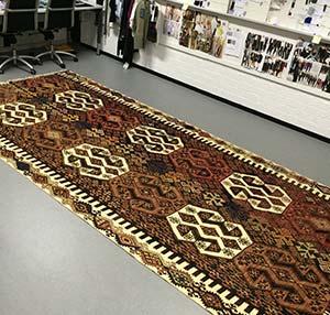 Vintage kilim rug in office